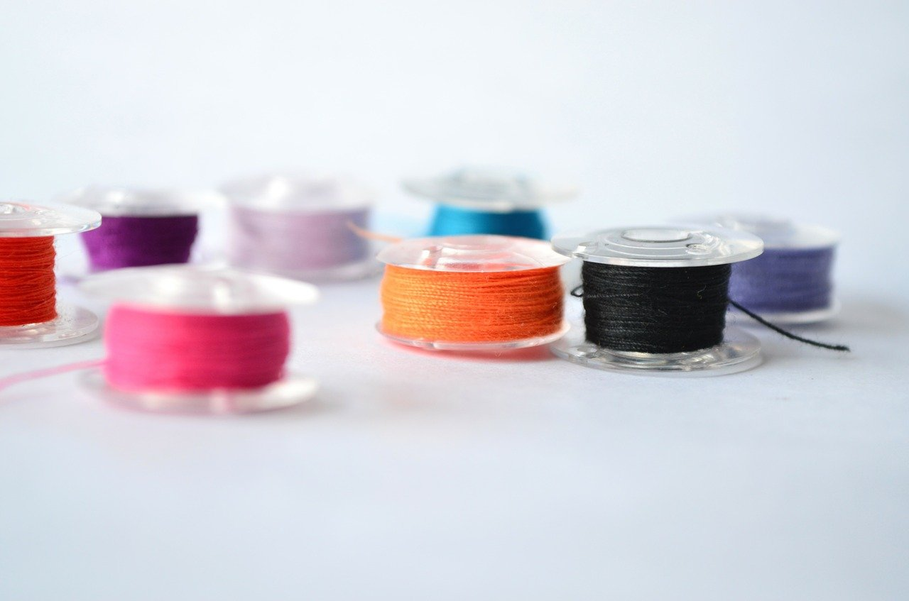 bobbin with threads isolated on table surface