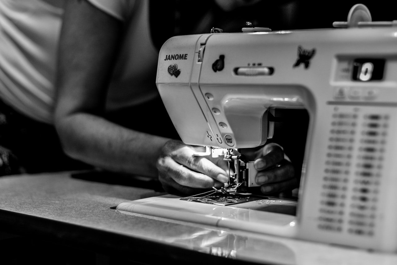 person checking his sewing machine