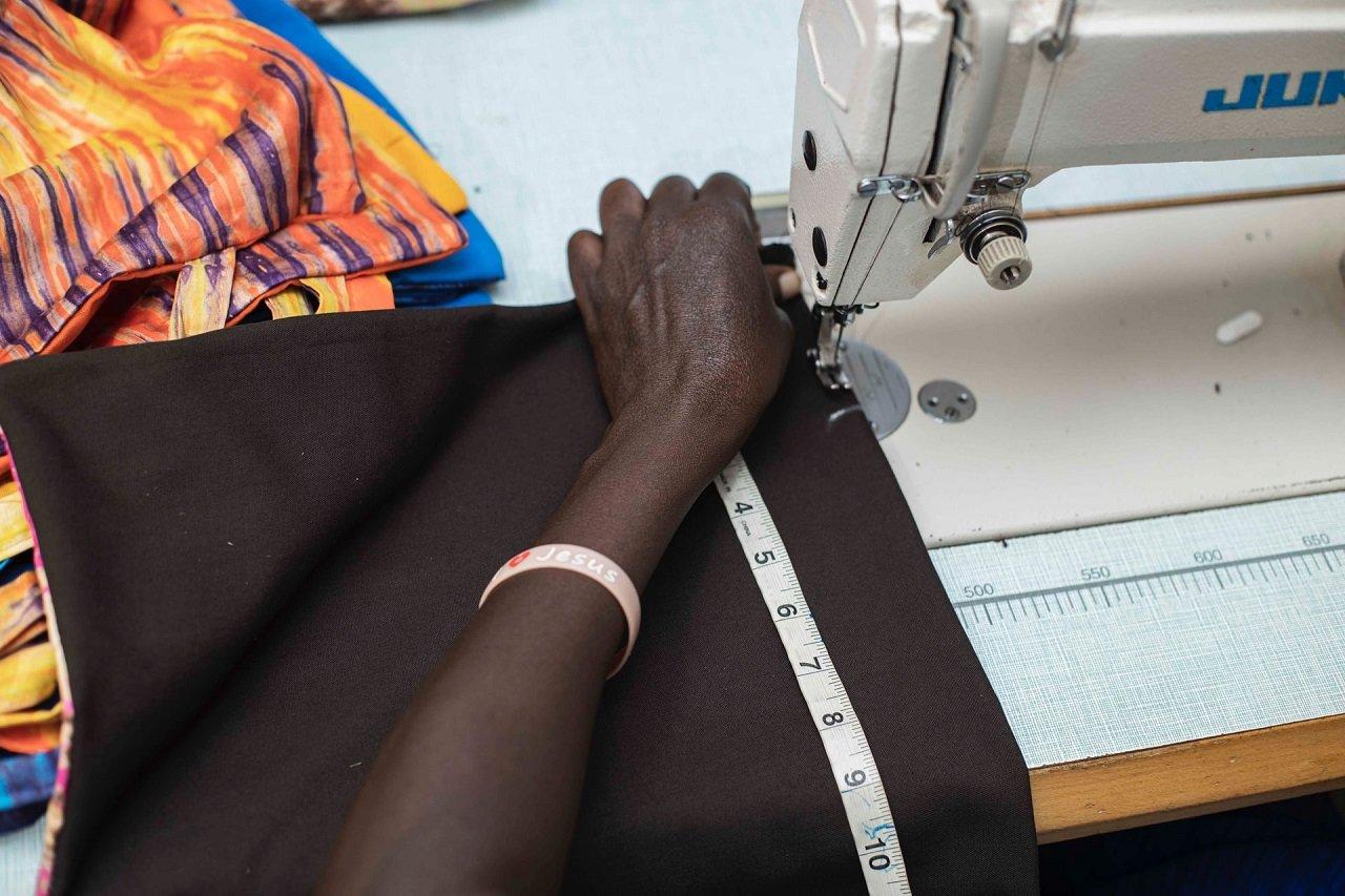 women using electric sewing machine
