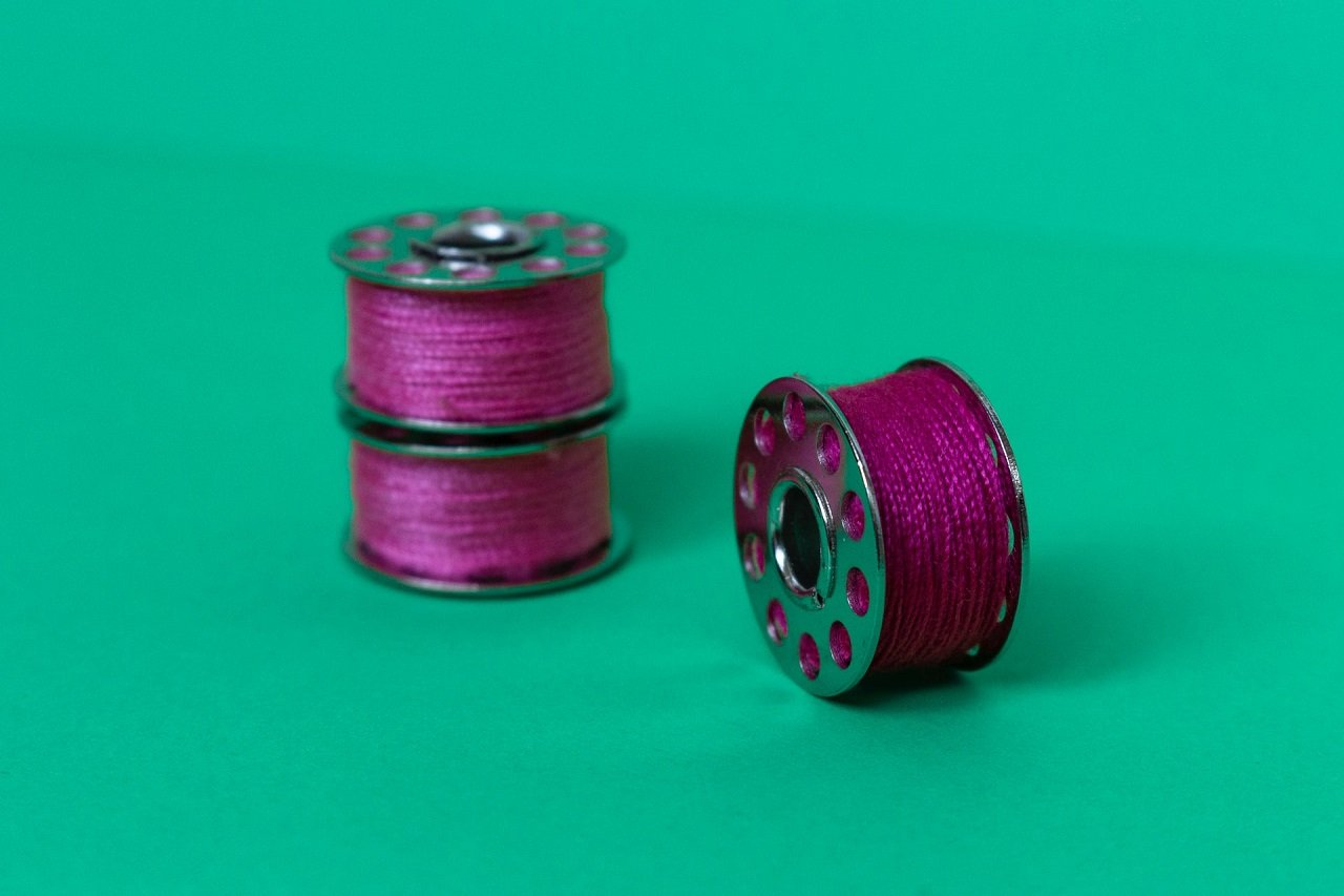 sewing machine bobbin filled with thread