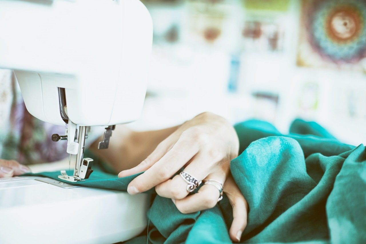 sewing with small white sewing machine